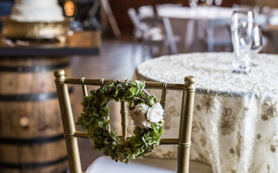 Copy of bridal chair with cake in the background