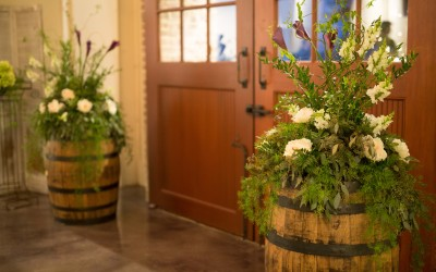 Flowers on whiskey barrels